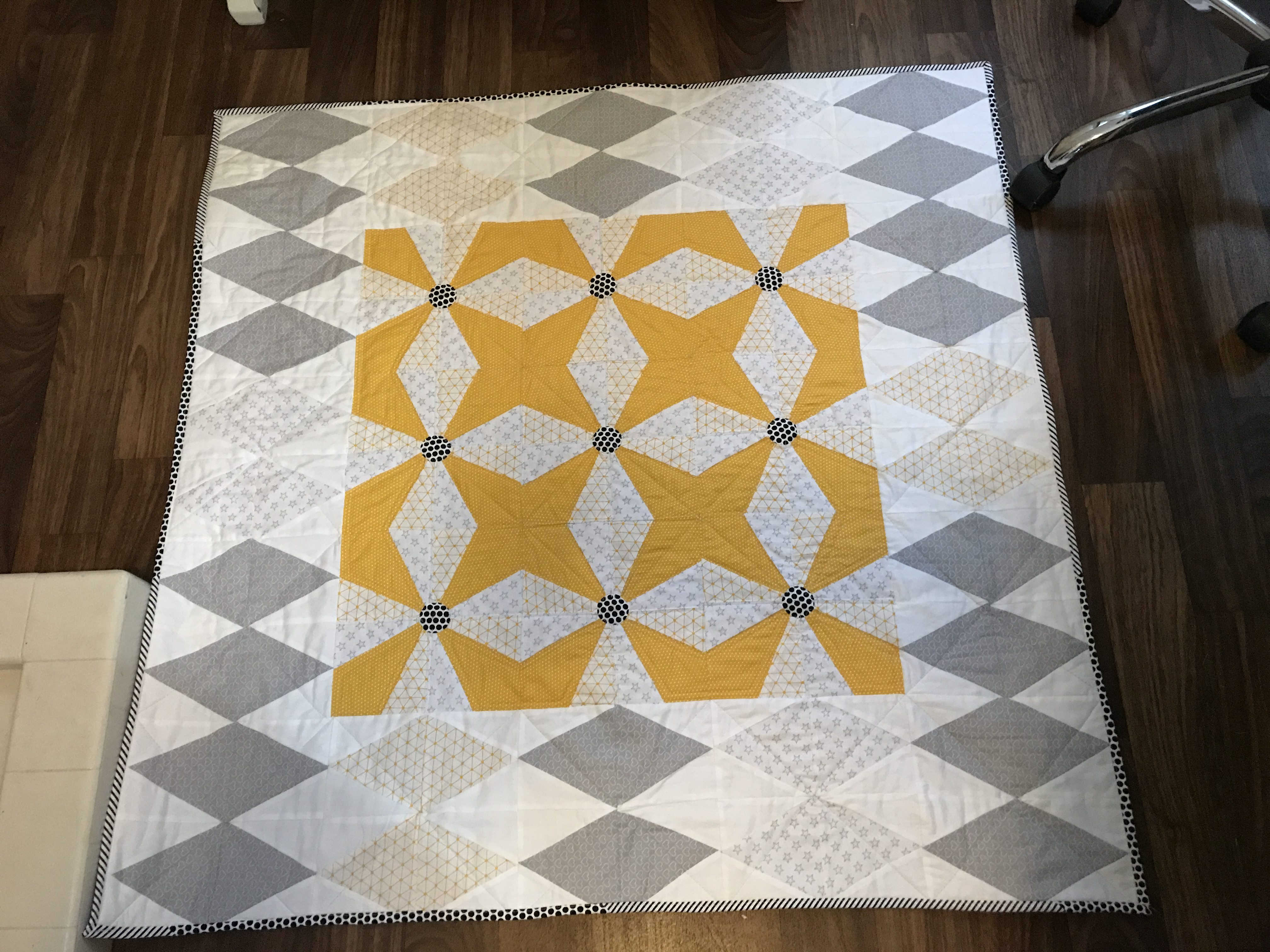 Small lap quilt made with the new Angles companion set